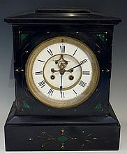 A Victorian black slate mantel clock of architectural form, the shallow can