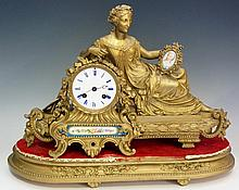 A 19th Century French mantel clock, the drum shaped case with ribbon twist