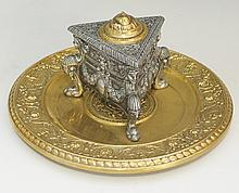 A French brass and white metal inkwell, the triangular well cast overall wi