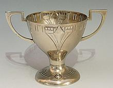 A WMF two handled pedestal goblet embossed with Art Deco motif and pierced