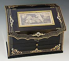 A 19th Century French gilt metal mounted letter rack and writing compendium