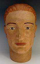 Advertising - a polychrome decorated plaster male head, 29cm high, possibly