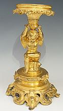 A French? Ormolu table centrepiece, the circular top with foliate and scrol