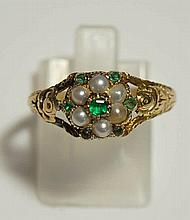 A ladies 18ct gold emerald and seed pearl ring the central flower shaped se
