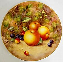A Royal Worcester circular plate still life painted with apples, cherries a