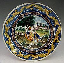 A 19th Century circular Faience dish painted to the centre with a woman sea