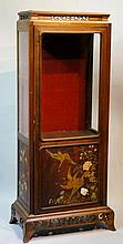 A Japanese display cabinet with waisted cornice, pierced floral trail above
