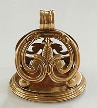 An early 19th Century gold fob seal the scrolling leafy frame centred on a