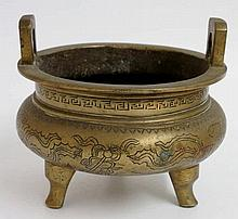 A Chinese bronze censer of shallow cauldron shape, pair of pierced handles