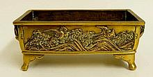 A Chinese bronze rectangular planter or censer, the body cast with birds am