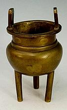 A small Chinese bronze censer of bellied cauldron shape with pierced geomet