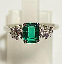 A ladies 18ct white gold emerald and diamond ring the cushion cut emerald c