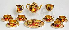 A Royal Worcester tea service comprising teapot, sucrier, cream jug, six cu