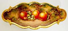 A Royal Worcester shaped oval dish with gilt gadrooned rim, still life pain