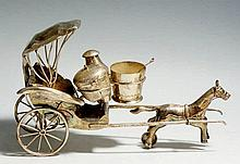An unusual Chinese cruet realistically formed as a rickshaw with horse, the