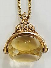A 9ct gold fob seal of unusually large proportions with faceted swivel topa