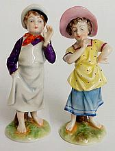 A pair of Continental porcelain miniature figures of a young boy and girl s