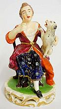 An early 19th Century Derby figure of a seated woman with dog on her knee,