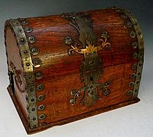 An oak domed topped box applied coppered white metal strap work mounts, the