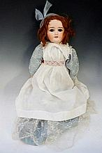 A Schoenau & Hoffmeister doll with sleeping eyes, ball jointed body, impres