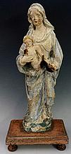 A 17th Century Spanish polychrome decorated figure of the Madonna and child