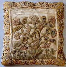 A late 17th/early 18th Century stump work embroidered cushion with central