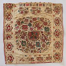 A late 17th/early 18th Century embroidered piece of linen with central styl