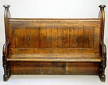 A Victorian oak Gothic pew with arched carved panelled ends with octagonal