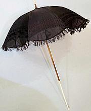 An 19th Century ivory handled parasol, knop shaped terminal oak shaft, brow