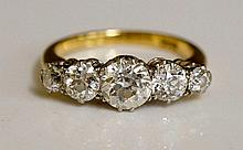 A lades 18ct gold five stone diamond ring, claw set with circular brilliants in pierced shank