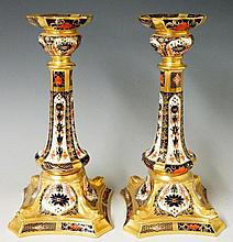 A pair of Royal Crown Derby pattern 1128 table candlesticks, 26cm high, printed mark in red, modern