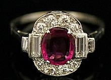 A platinum ruby and diamond ring, the untreated oval ruby within a border of ten pavé set brilliants and four cushion cut stones, ruby approx. 1.48 carats, ring size T