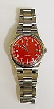 An Omega Seamaster with red dial, calendar aperture at 3, steel bracelet, dial 3cm diameter