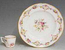 A Derby shaped circular plate painted to the centre with a floral spray within a border of gilt seed and flower heads, gilt lined rim, 23cm diameter, impressed mark; a Stevenson & Hancock tea cup finely painted with poppies, roses and other flowers,
