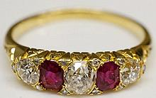 A yellow gold ruby and diamond ring, the pair of oval cut rubies flanked by round cut brilliants, cast shoulders, rubies approx. 0.64 carats, total estimated diamond weight 0.8 carats, I SI1, ring size R