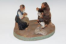 A Neapolitan terracotta figure group of monk, mother and child, oval base,