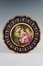 A shaped circular Worcester cabinet plate finely painted to the centre with