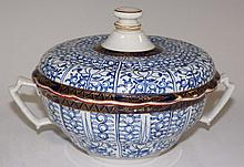 A Worcester Royal Lilly pattern shaped circular two handled tureen and cove