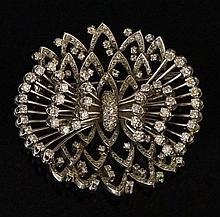 A diamond set platinum brooch of pierced oval design, 5 cm wide, 48 gms, 6