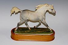 A Royal Worcester model of an Arab Stallion modelled by Doris Lindner, '' I