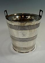 A silver plated sleeved tapering cylindrical ice bucket with pair of rectan