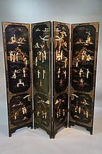 A Chinese black lacquer four-fold screen decorated in ivory, hardstones and