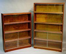 A Minty stacking bookcase, five section with glazed sliding doors, 146cm high, 90cm wide; another Minty bookcase, four section, glazed sliding doors, 116cm high, 89cm wide (2)