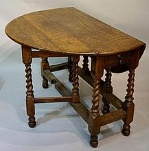 An oak oval gate leg dining table the oval top above barley turned supports joined by moulded stretchers, 116cm x 100cm oval, 76cm high, late 17th Century / early 18th Century (faults)