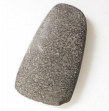 A Neolithic granite axe head, 15cm wide (chipped)