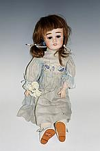 A French Limoges doll, pale bisque head, pierced ears, flip back eyes and l