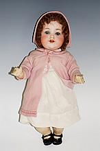 An Armand Marseille German doll with bisque head and flip back eyes, mold n