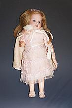 An Armand Marseille German doll mold 390, bisque head, flip back eyes, full