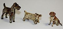 Three cold painted bronze dogs comprising two terriers and one hound, 7 cm
