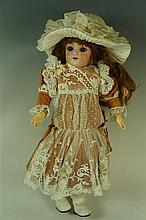 A Simon and Halbig bisque headed small child doll with flip back eyes and a